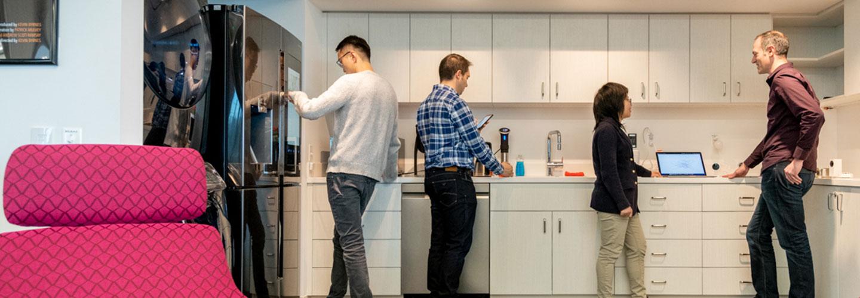 People talking in office kitchen